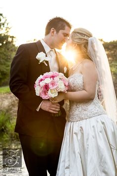 Beautiful romantic and touching photo of a bride and groom at sunset. I call this the almost kiss. Bride is wearing a two piece beaded and satin wedding gown with a beaded veil and pink roses bouquet. The venue is a golf and country club in Rancho Murietta California CA. Farrell Photography is the award winning team of photographer Steve and Stephanie Farrell. Wedding photography, portrait photography, boudoir photography, in Northern California, Sacramento Lake Tahoe and destination.