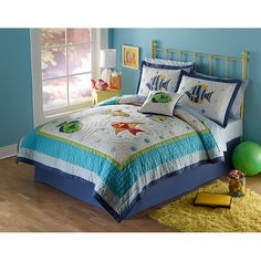 This applique quilt set is sure to bring a splash of color to any child's bedroom decor. This prewashed soft cotton bedspread and two shams are highlighted with bright sea-themed appliques and patchwork. It's machine washable for ease of care.