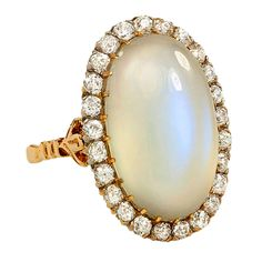 Circa 1930 Moonstone and Diamond Ring...i little smaller but white gold..that would be the most amazing engagement ring ever