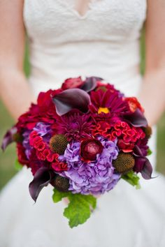 Nice fall floral mix. Could add a pop of orange to offset the deep burgundies and purple. Flowers include hydrangea, dahlias, callas, and cock's comb.