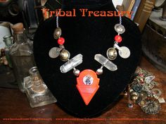 Red talhakimt necklace with quartz crystals, vintage turkoman buttons, old chandelier crystals, clear faceted czech glass beads, red discshaped ceramic beads from India, small titanium crystal beads, silver czech sead beads, and chain.