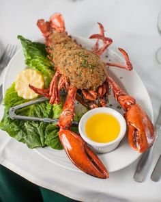 Baked Stuffed Lobster with Chef Avi | Delicious baked stuffed lobster with scallops and shrimp. Mounded with moist, buttery stuffing and chock full of enough seafood to make a whale jealous. You might not even need the drawn butter!