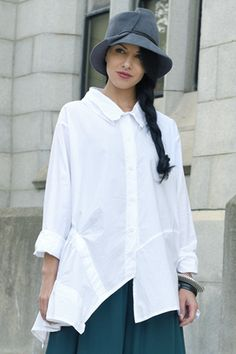 A classic white shirt with a whimsical twist. Small gathers on the collar make it sculptural, while the flourish on the side take this shirt to the next level! Fabric: Carnaby (Lightweight Cotton) Colour: White Available In Classic White Shirt, Mode Boho, White Shirts, Timeless Fashion, Shirt Style, Shirt Designs, Teal, Vienna, My Style