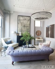 Harriet Maxwell Macdonald and Andrew Corrie's Manhattan loft; mirror, light fixture, settee, and nesting tables are all by Ochre, the home-furnishings shop the couple owns ~ foto William Waldron