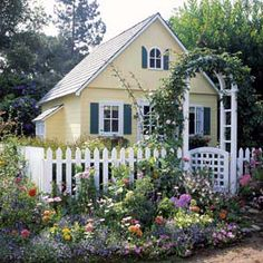 A charming combination of colors and materials dresses up this garden playhouse. Part of the appeal? The fence and arbor, details picked up from the designs found in full-size cottage gardens. Garden Cottage, Cozy Cottage, Cottage Homes, Cottage Style, Home And Garden, Cottage Living, Build A Playhouse, Playhouse Outdoor, Garden Playhouse
