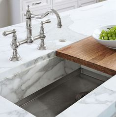 I want a sink with no faucet, the faucet drops down, hidden in the cabinet above, and a chopping block that folds down to cover the sink, a chute that goes to the compost shute to the garage.