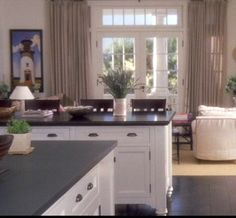 I LOVE this kitchen from the movie Something's Gotta Give. It's one of my all time favs. I wish I could transport the whole thing into my house.:)