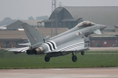 RAF Eurofighter Typhoon II in invasion stripes like it's predecessor in 1944, for the anniversary of D-Day commemorations.