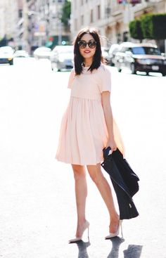 Take a note from Anh and layer a sleek moto jacket over a sweet babydoll dress. // #Fashion #note