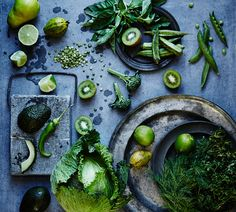 Stock Photo : High angle view of green fruits and vegetables on plates