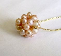 Gold and Salmon Pearl Cluster Necklace by beadup on Etsy