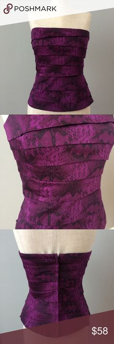 Purple Layered Bustier White House Black Market Strapless bustier with build in structure and grip fabric to keep this secure when you are wearing it. The edgy exotic print is timeless and keeps this silhouette fun but classy.  This brand makes my favorite quality bustiers that fit and feel comfortable through the day.  Pair this under a jacket or on its own! No damage in excellent condition. White House Black Market Tops
