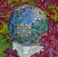 """Garden GaZing Ball""  Repurposed bowling ball,mirror,glass,tiles,globs,millefiori,ceramic leafs"