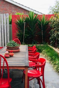 Outdoor Living | Don't be afraid of a little color. A bold red can add a lively punch to your patio. We feel so much cheer when we look at this image!