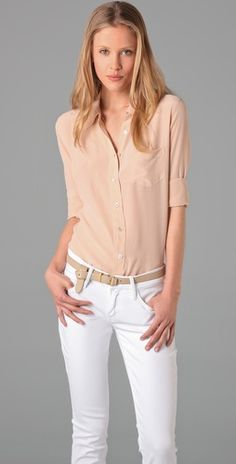 """Equipment Brett Shirt $208 This silk blouse features a fold-over collar and an 8-button closure. Patch bust pocket and shirttail hem. Knife pleat at double-button cuffs. Long sleeves. Semi-sheer.    * 27"""" long, measured from shoulder.  * Fabrication: Washed silk.  * 100% silk.  * Dry clean.  * Imported."""
