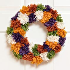 This fun and unique pom pom wreath is perfect for fall and easy for kids to make!