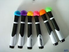 Hot glue a pompom onto the end of dry erase marker to use as an eraser. GENIUS!
