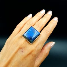 This large cobalt blue beautiful labradorite ring will take your breath away! Wear this magical flashy crystal as an everyday statement piece that goes with any wardrobe style. This labradorite ring features a rectangular shape, shimmering shades of blue and a modern design.  I love wearing labradorite rings for empathic protection. Wear this ring to protect your aura when you're out running errands, going to work or attending events with lots of people.