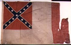 """Third National Confederate Flag. This flag was also known as """"the Blood Stained Banner"""" and was adopted on March 4, 1865. The red vertical bar was proposed by Major Arthur L. Rogers, who argued that the pure white field of the Second National flag could be mistaken as a flag of truce: when hanging limp in no wind, the flag's Southern Cross canton could accidentally stay hidden, so the flag could mistakenly appear all white."""