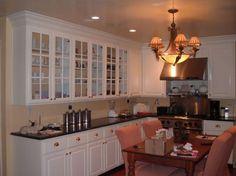 Google Image Result for http://www.kitchenideasmodern.com/wp-content/uploads/2012/04/White-Kitchen-Cabinet-Glass-Doors-550x412.jpg