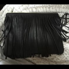 """Black Vegan Leather Fringe Clutch 12x9 from BG This arrived in the mail and I thought Bergdorf Goodman had made a mistake and sent me a Stella McCartney bag, it's that nice. It wasn't, it was a """"gift with 1k purchase"""", just kidding, but I did spend a great deal of $$ to get this bag. I wasn't going to consider selling it, since I didn't technically buy it, but sure enough, I checked on eBay and its selling for $19.99. It's substantial, fringe lies flat and it's quite large, but not deep…"""