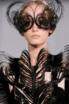 Netherlands based fashionista Iris Van Herpen who has worked with Mcqueen presented her FW11/12 haute couture collection & remains an outsider in this commercialized world of high end fashion. This design is the  black wings dress.