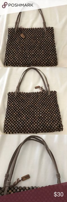 The SAK by Elliot Lucca wooden beaded bag Brown wooded net bag! Super unique and fun carry bag or over the shoulder bag.  Has a zipper inside.  Closes with a magnetic button.  Handles have some wear.  Used bag.  Width 10.5 inches by 9 iches in height The Sak Bags Shoulder Bags