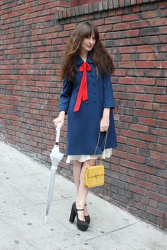 This girl is too too cute. Love the yellow hand bag too.