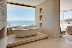 I can't get enough of bathrooms with beach views. I love these super large floor tiles and how they elevated the stand alone tub by placing. Luxury Villa, Luxury Life, Luxury Hotels, Large Floor Tiles, Bathroom Stand, Stand Alone Tub, Le Cap, Location Villa, Amazing Spaces