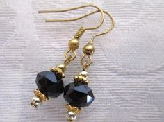 """For this pair of earrings I used opaque black glass crystals and gold tone findings.  The length is about 1-1/4"""" from the top of the ear wires, the width is about 5/8"""".  My jewelry will come in a handmade box and a cute little free gift!   See more: handmadeartists.com/shop/KOKOSGIFT Questions? Email me: TonyTheBeat@aol.com  (1213)"""