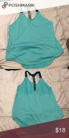 Nike turquoise tank Perfect condition!!! Nike Tops Tank Tops