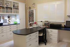 The window wall.Plantation shutters allow lots of light to flood the room (when open). My counter extends out to a large peninsula with lots of work space.