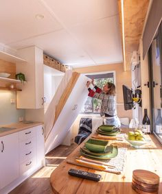 Inside the Beach Shack is a murphy bed in the living room, bar height dining table, and several storage areas. Small Tiny House, Tiny House Living, Tiny House On Wheels, Small Living, Living Room, Murphy Bed Ikea, Murphy Bed Plans, Small Room Design, Tiny House Design