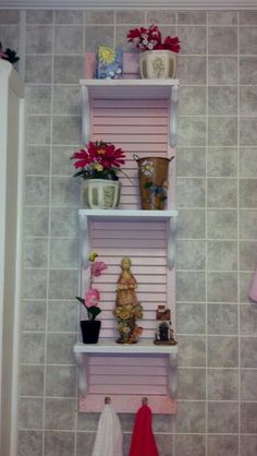 Old louvre door....shelves from plywood....brackets, clearance at Lowes. Pink n white spray paint....sea foam sponge for the modge podge look around edges:)