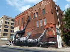 this is street art done by the artist ROA, it's on the former Star Hotel in Atlanta. I'll have to go find this. Street Art, Street View, Old Bricks, Brick Building, Mural Art, Old English, Art Lessons, Landscape Design, Atlanta