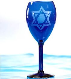 Turn ordinary blue goblets into a memorable part of your Hanukkah festivities. A simple etching process adds a Star of David motif to the glasses. Combine with other themed tableware to create a setting that will add meaning to your holiday entertaining.