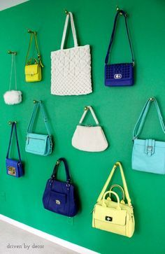 Cute wall of purses in a girls room - used as wall art plus storage for hairbands and other trinkets