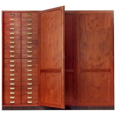 Apothecary Armoire / by Rud. Rasmussen / Denmark, 1940s / with eighty individually numbered drawers with brass pulls, five large drawers and two adjustable height shelves