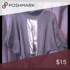 NWT Grey Bebe Batwing Turtleneck Size S New with tags. Grey/silver sequin accents down front. Shirt is opened down front as well and does require something be worn underneath. Great for fall/winter! bebe Sweaters Cowl & Turtlenecks