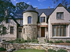 Like the cylindrical towers, steep roofs, and decorative timber of French Normandy style homes.