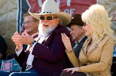 Charlie Daniels and Dolly Parton sit next to each other at Nashville's Walk of Fame Induction in 2009
