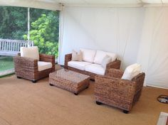 Indoor Rattan Set - with one sofa, two armchairs and one coffee table with a glass top.