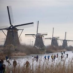 Holland - ice skating: I lived in Kinderdijk for a year, next to the windmills in the early . Idillic today, next to the nature reserve. Netherlands Windmills, Holland Netherlands, The Places Youll Go, Places To Visit, Places To Travel, Winter Wonder, Le Moulin, Nature Reserve, Photos