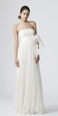 Vera Wang    DYLAN  Strapless full babydoll sheath with lace bodice and criss cross bow  Without the bow, though.