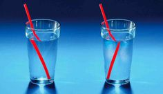 Light refraction in a glass of water makes a straw appear to be broken or bent