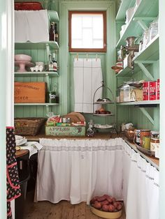 Celadon-green pantry with country laundry instead of cabinet doors. Reminds me of… Celadon-green pantry with country linens in lieu of cabinet doors. Reminds me of the pantry in the triple-decker I lived in as a young married. - Own Kitchen Pantry Cozy Kitchen, Kitchen Pantry, Country Kitchen, Kitchen Decor, Green Kitchen, Kitchen Ideas, Kitchen Walls, Kitchen Rustic, Kitchen Corner