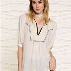 Selena Tasseled Top Beautiful Spring Blouse.   Rayon Gauge- V-Neckline with lace patch and tassel detailing.  Short sleeve Tunic.  100% Rayon.   Available In Small Medium and Large.  Please do not purchase this listing.   Contact me and I will create your own listing. Lewboutiquetwo Tops Tunics