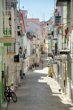 Pedestrian street of Nazaré, Portugal  Fantastic, I can just smell the grilled sardines!!!