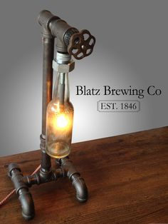 Items similar to Industrial Brewery Lamp - Blatz Brewing Company - Steampunk Fixture - Bar Decor Lighting on Etsy Pipe Lighting, Industrial Lighting, Industrial Style, Industrial Pipe, Vintage Industrial, Diy Luminaire, Deco Restaurant, Pipe Lamp, Pipe Desk