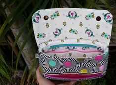 Here's a sewing pattern for this very stylish modern bag The Zelie Clutch. It has masses of room for all of your essentials and is wonderfully comfortable to carry with or without the optional strap. The pattern allows you to include both a detachable shoulder strap and a wristlet strap option to allow for hands-free carrying. With two magnetic snaps holding down the flap closure all your valuables are kept securely inside.